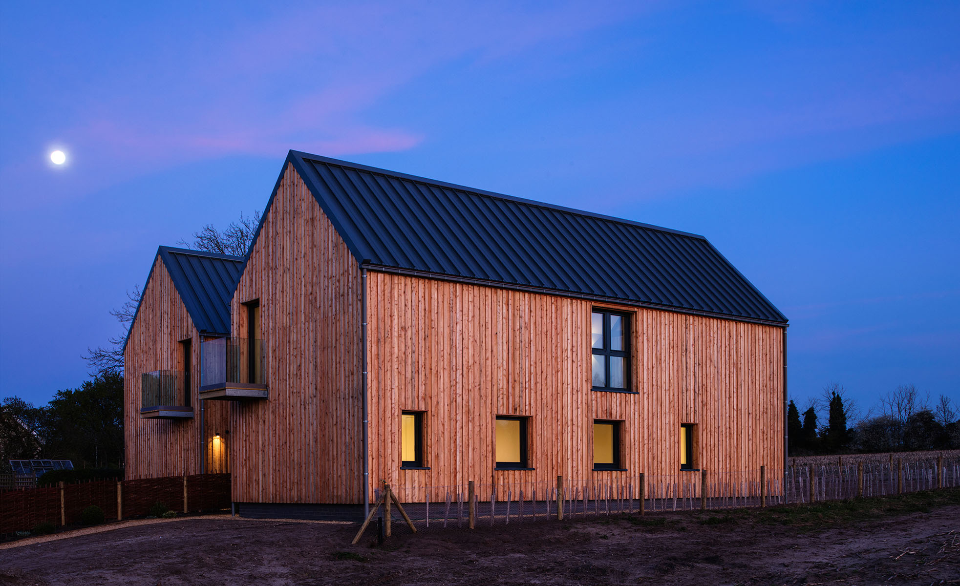 Two neighboring low energy houses built to Passivhaus design principles in arable land in Area of Outstanding Natural Beauty near the Suffolk coastline.  Client: Greentithe / BLDA