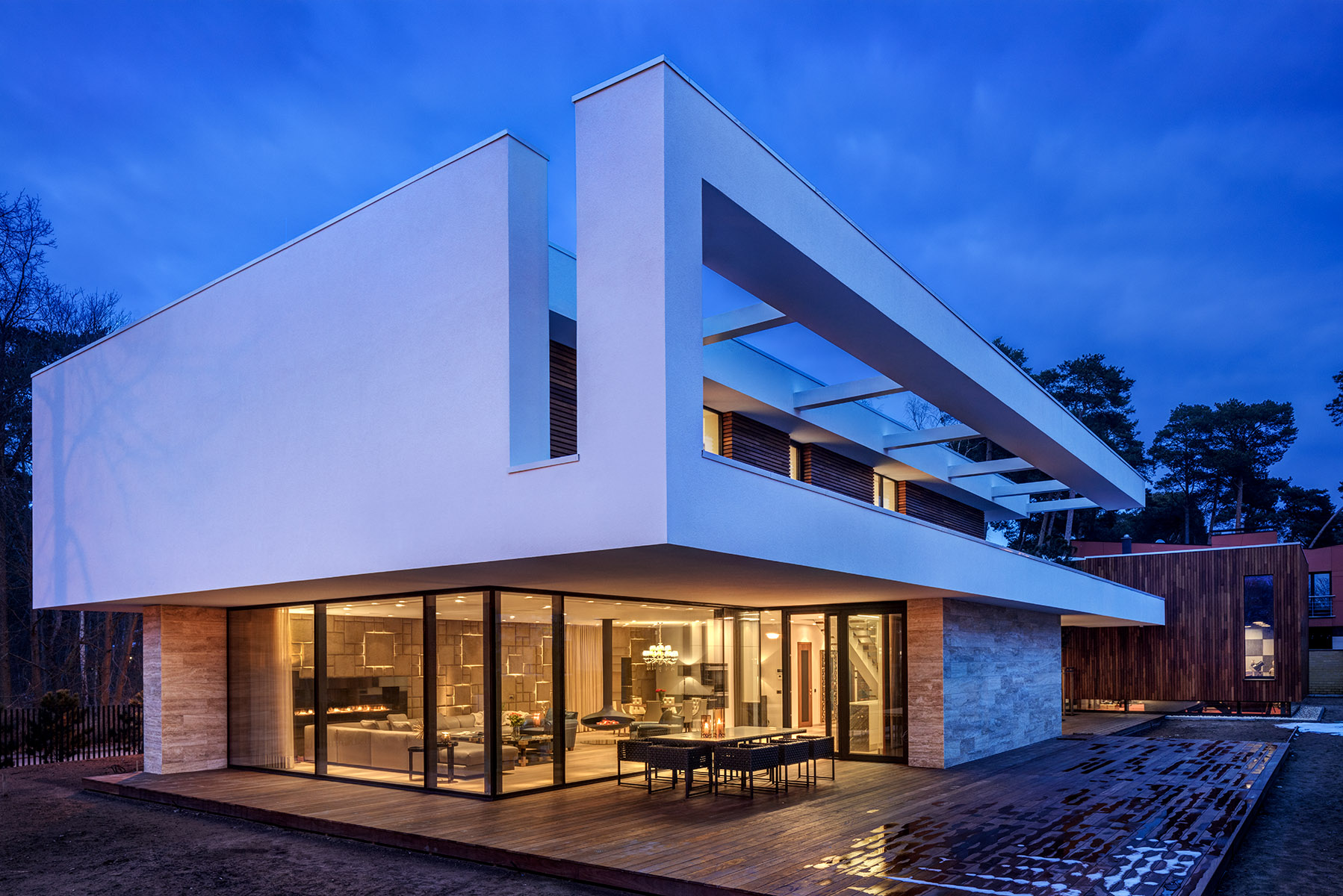 New Build Modernist style house set in forest on two levels with large open plan living space. Client: MadamW
