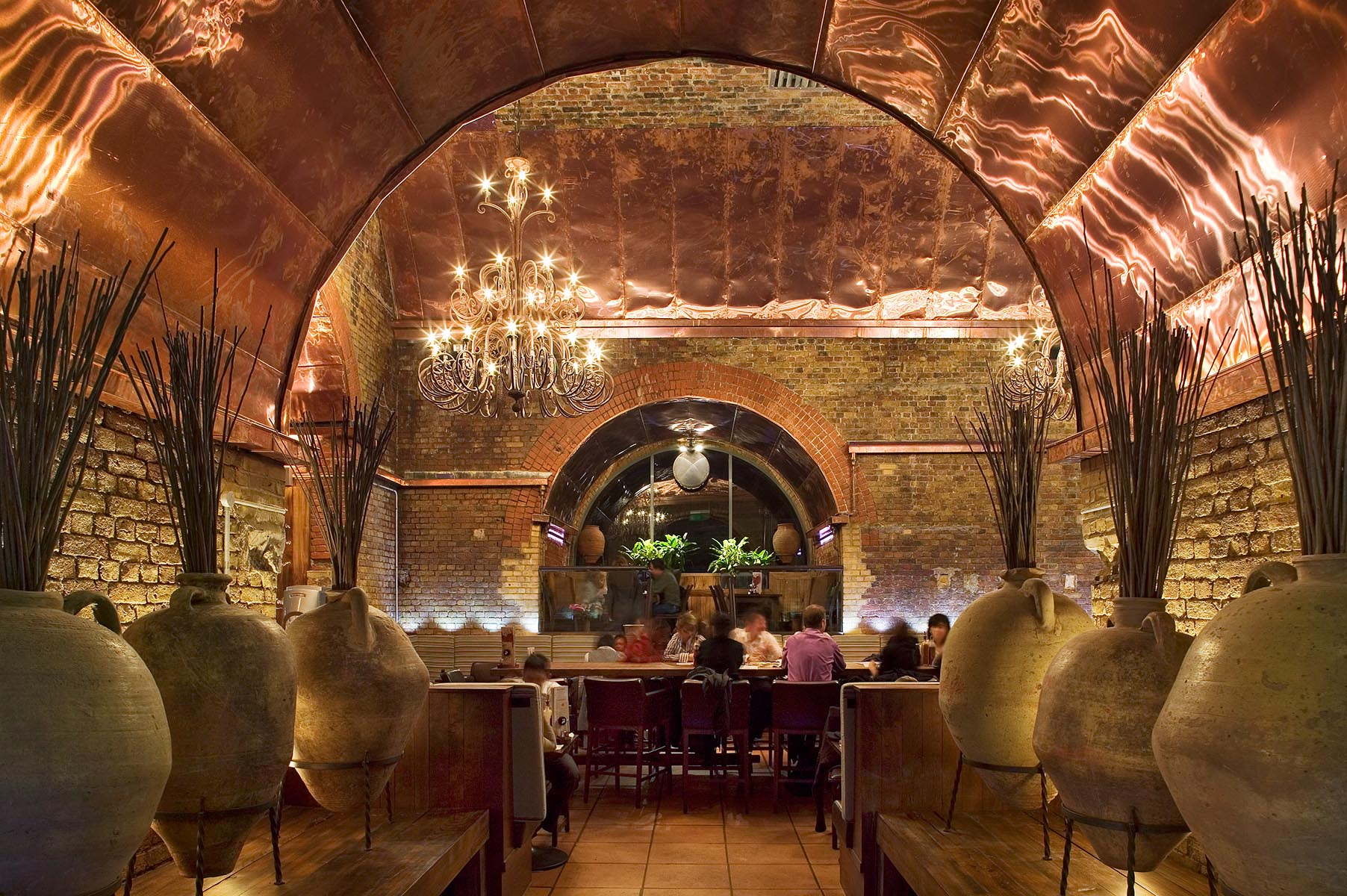 Mid-range restaurant set in transformed railway arch with copper vaulted ceilings.Client: Network Rail