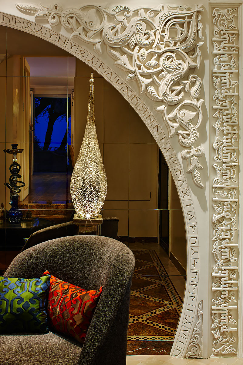 Detail of arabesque style relief mirror wall of spa in private house in Èze, Côte d'Azur, France