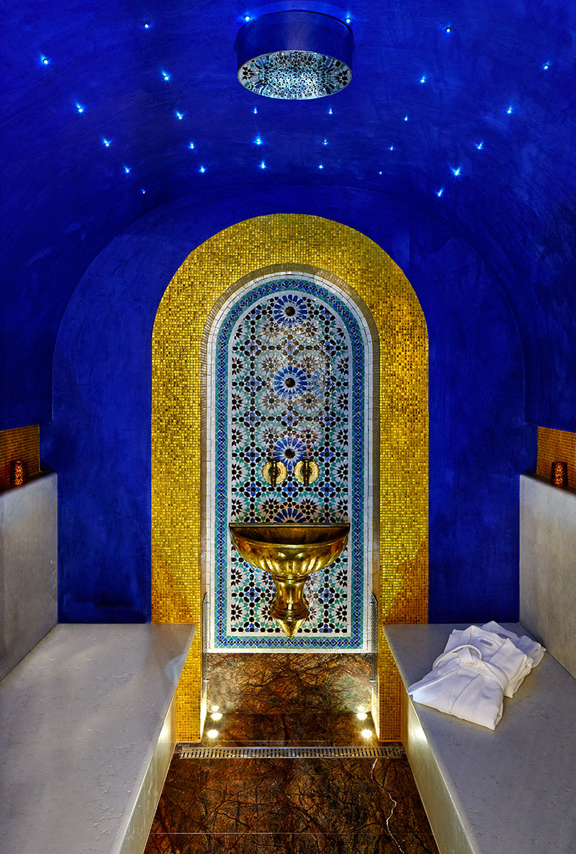 Steam room with Blue and gold tiels and elaborate fountain in arabesque style in spa in private house in Èze, Côte d'Azur, France