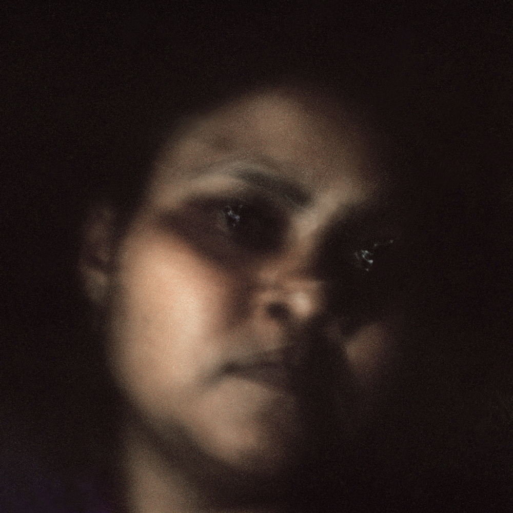 "Ranjana Manoj Chaudhury, 31, became a widow in 2004. Her husband, farmer Manoj Prahladroa Chaudhury, 38, consumed pesticide and died on the very farm he was trying to cultivate on December 24, 2004. ""He kept saying I won't be here for long as I am under a lot of tension, but he never specified anything."" Two or three years before he took his own life, Manoj had taken out two loans to put money into the family's six-acre land. The loans, from both private lenders and banks, amounted to 130,000 Indian Rupees (US$2,424).  The stress of being unable to repay the loan eventually culminated in suicide."
