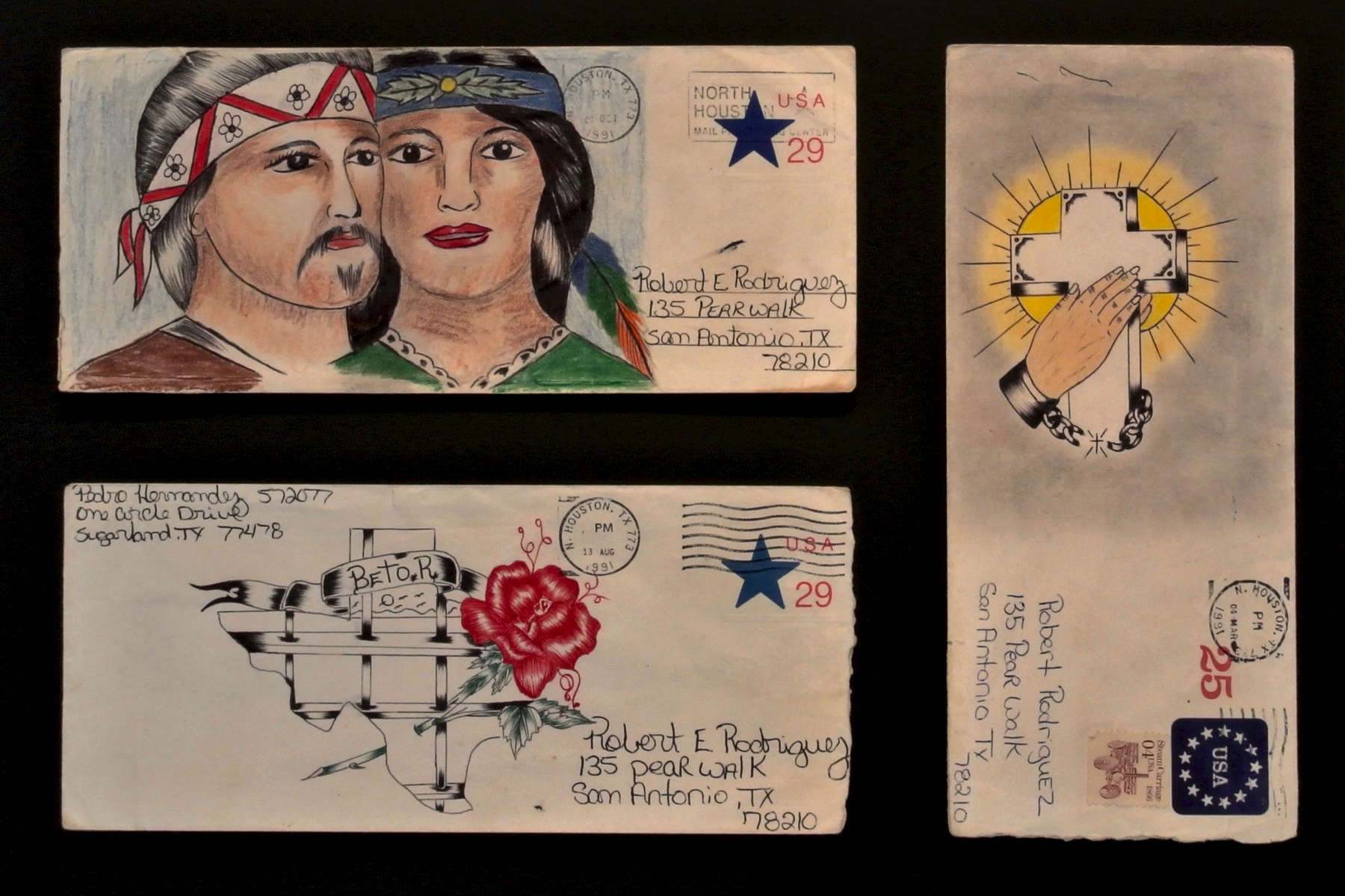 """Pedro HernandezGrouping of 3 Paños Envelopes*Framed size:  54,5 x 74,5 cmGraphite, colored pencil, pen and ink on stamped, franked envelopes1.  Hands and Cross, approx. 24,2 x 10,5 cm (95 x 41 inches) 2.  Indian couple, approx. 24,2 x 10,5 cm (95 x 41 inches)3.  """"Betor"""" with rose, approx. 24,2 x 10,5 cm (95 x 41 inches)*Chicano inmates use hand-decorated envelopes in color or black and white to mail letters and paños (prisoner folk art made on a handkerchief). Demand for these envelopes can provide a profitable business for a convict skilled in drawing.Please click here for a comprehensive essay on paños by Martha V. Henry."""