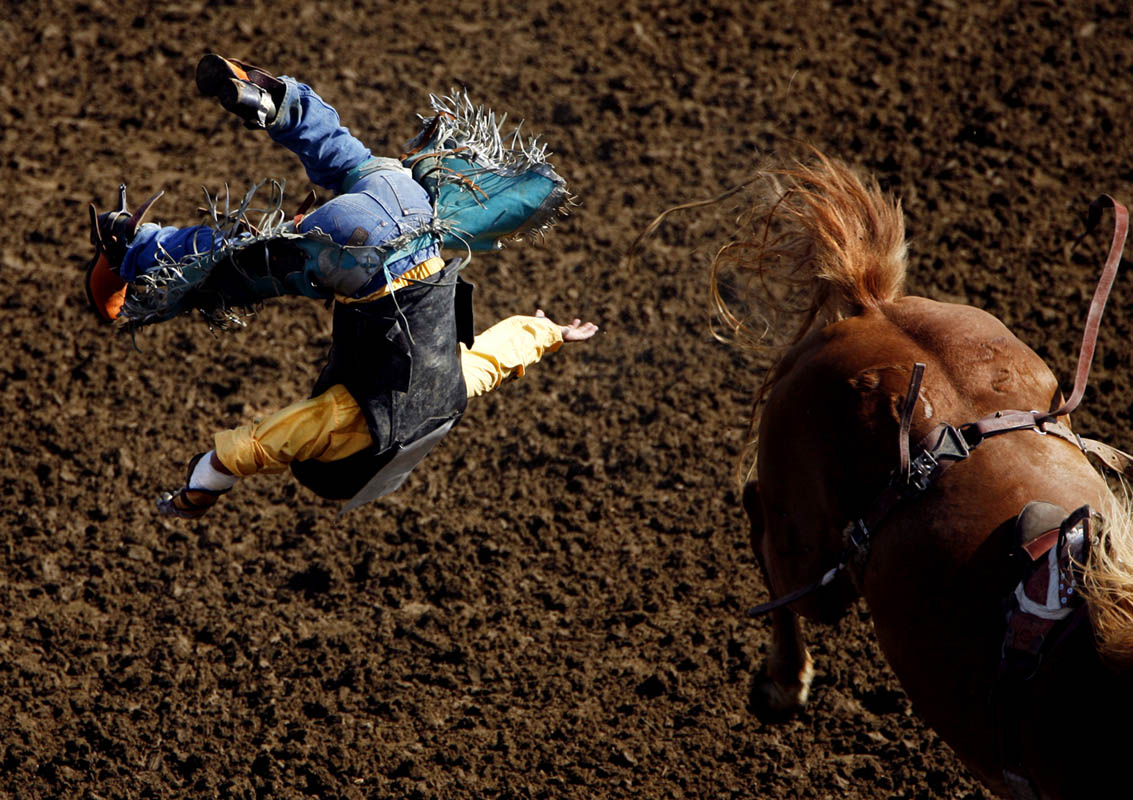 Tucker Brengle of South Dakota is tossed during bareback riding Thursday during the National High School Finals Rodeo.