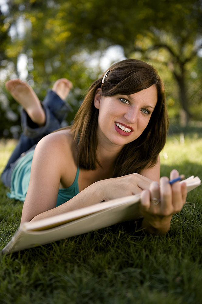 Courtney Sheldon, 18 years old, from Thousand Oaks, Calif., is sitting on the grass at Alice Keck Park Memorial Gardens in Santa Barbara, Calif., pondering and sketching her boyfriend on Saturday, September 26, 2009. Sheldon stated, {quote}I have always loved sketching because it is relaxing and a way to get out my creative side.{quote}