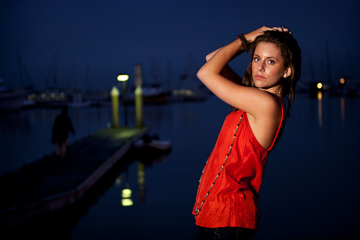 Grace Rocoffort De Vinniere, 19, from Malibu, Calif., is in front of ships and sailboats at the Santa Barbara Harbor in Santa Barbara, Calif., on Sunday, September 27, 2009.