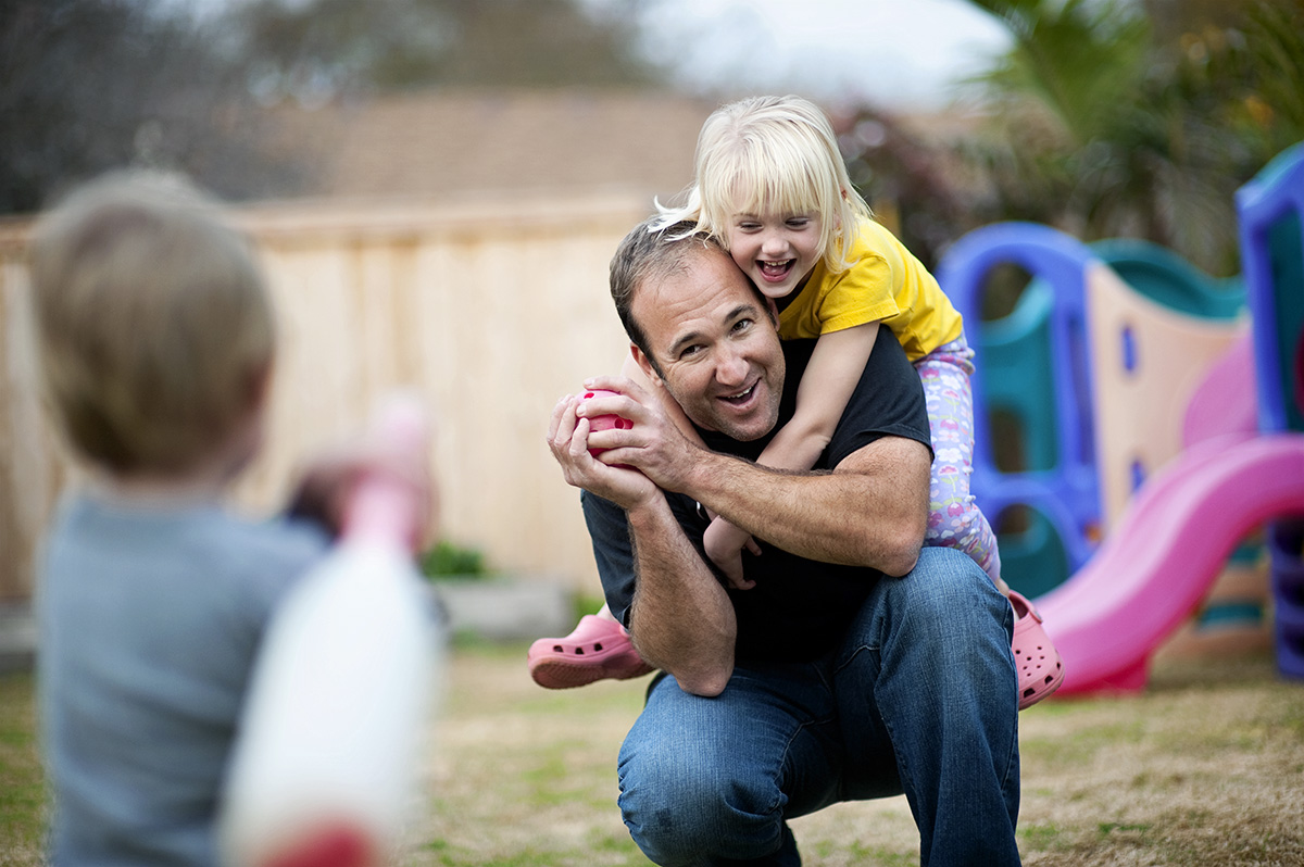 Brady Beck, 37, a Santa Barbara fireman, from Ventura, Calif., is playing baseball with his kids ,Sophie, 5, and Brady Jr., 2, on one of his days off in their backyard in Ventura, Calif. on Monday, February 1, 2010. {quote}I have so much fun watching them grow up and spending time with them,{quote} Beck said.