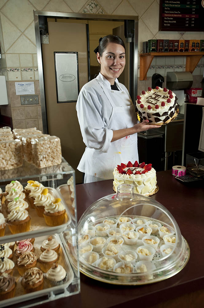 Cake decorator, Heather Curtis, 23, from Santa Barbara, Calif., is displaying her recently decorated cakes and cupcakes at Jeannine's Bakery inside Gelson's Market in Santa Barbara, Calif., on Sunday, Feb. 21, 2010. Curtis said, {quote}I like making cakes pretty, it's fun!{quote}