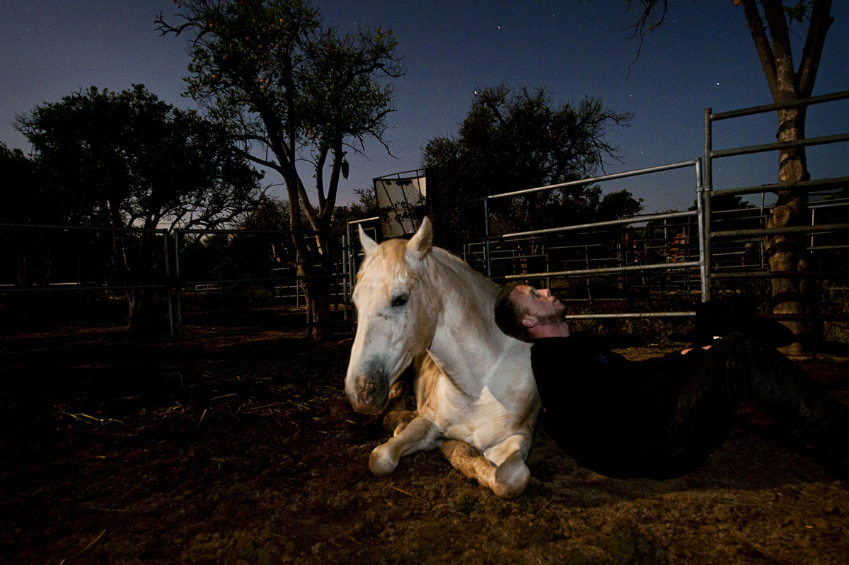 Shawn Dent, 22, from Ventura, Calif., is looking at the stars with his self-proclaimed {quote}big puppy,{quote} Amigo, around 1 AM on Friday, May 20, 2011 in Ojai, Calif., at the California Coastal Horse Rescue. Dent and Amigo share a special bond. A friendship that allows a rescued horse lay down with his human friend in the middle of the night comfortably. {quote}I would come here at night time even when I was 15 years old when I first started driving,{quote} Dent continued, {quote}it is just a nice and peaceful area.{quote}