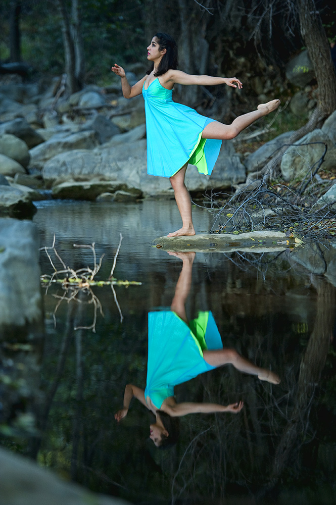 Annalyse Olivas, 21, from Ojai, Calif., is balancing and portraying the emotion of hope on an island rock in the middle of a still creek in Matilija Canyon in Ojai, Calif., on Tuesday, November 15, 2011. Olivas said she wants to communicate {quote}hope, inspiration, and confidence,{quote} in her dancing.