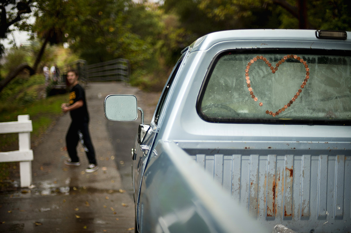 Near a creek in San Luis Obispo, Calif., on Sunday, November 20, 2011, teenage boys left their truck parked in the center of the dead end  road while they spent the afternoon playing in the rain. One of the boys  claimed a family member created the heart full of pennies on the back window.