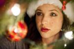Jenna Bair, 25, from Newbury Park, Calif., is hanging Christmas bulbs on her parent's Christmas tree on Monday, November 28, 2011, while enjoying the holiday season with joyful music. Bair's black labrador retriever, Buddy, was amused by all the decorations.