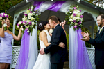 Groom, Jeff Grant, 38, from Huntington Beach, Calif., kisses his bride, Eva Wu, 30, from El Monte, Calif., to be husband and wife at an ocean view home in Malibu, Calif., on Saturday, October 27, 2012. The two were wed in front of the gazebo for an intimate ceremony with their close friends and family. Mr. Grant said, {quote}I love her personality,{quote} he continues, {quote}when we are together everything is easy, natural, and we have a good time.{quote} Mrs. Grant said, {quote}He makes me laugh all the time,{quote} she continues, {quote}He's sweet and spoils me all the time.{quote}