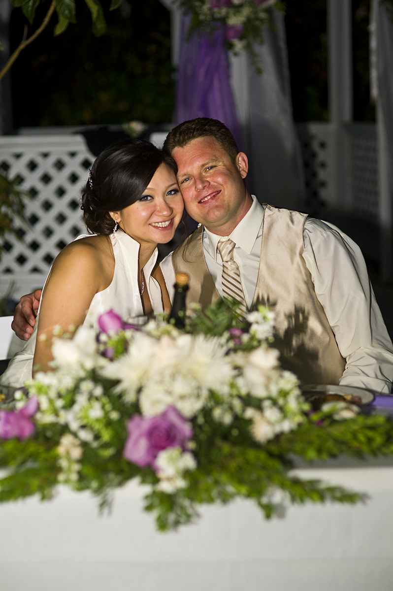 Groom, Jeff Grant, 38, from Huntington Beach, Calif., is with his bride, Eva Wu, 30, from El Monte, Calif., at their table during their reception  at an ocean view home in Malibu, Calif., on Saturday, October 27, 2012. The evening ended with plenty of dancing and great memories with their friends and family.