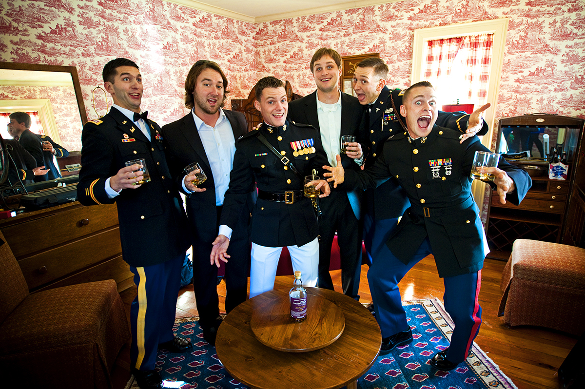 Duncan Carlton, 26, from Laguna Niguel, Calif., is with his groomsmen having scotch before the ceremony to be wed to his bride, Sarah Schultz, 28, from Laguna Niguel, Calif., at the Vesuvius Vineyard in Iron Station, North Carolina on Saturday, December 29, 2012. The wedding included customs such as a first look, sword arch entrance, cutting the cake with Carlton's sword, toasts, bouquet toss, tossing the garder, and lots of dancing.