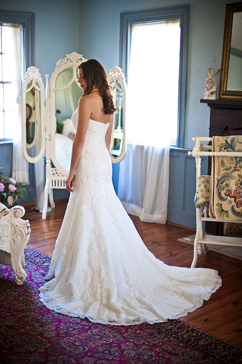 Bride, Sarah Ann Schultz, 28, from Laguna Niguel, Calif., takes everything in as she takes her last few moments in her beautiful bridal room before becoming a wife to Duncan Carlton on Saturday, December 29, 2012 at the Vesuvius Vineyard in Iron Station, North Carolina. Schultz completed her look with something old, something new, something borrowed, and something blue.
