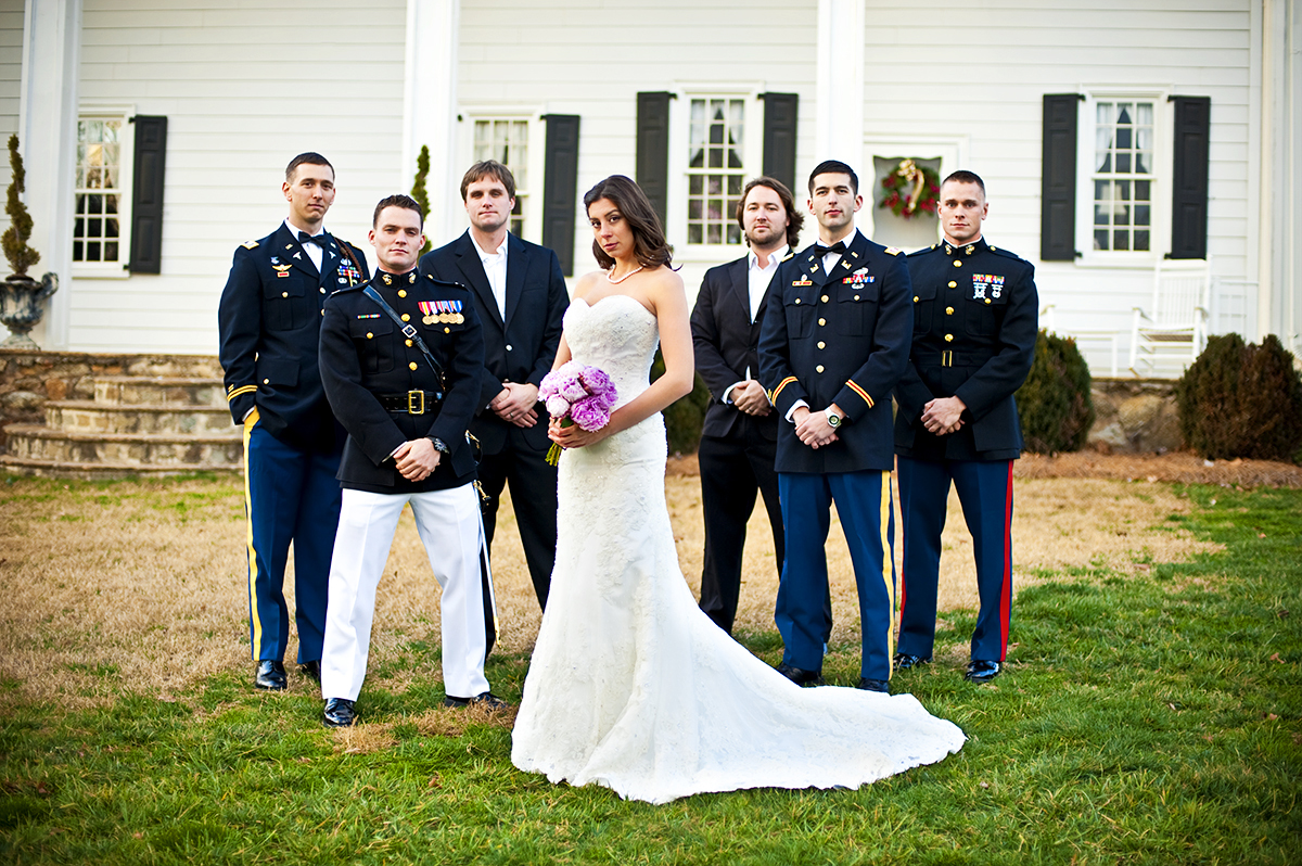 Winter Bride, Sarah Ann Schultz, 28, from Laguna Niguel, Calif., is surrounded by her Groom, Duncan Mark Carlto, 26, from Laguna Niguel, Calif., and his groomsmen on their wedding day at the Vesuvius Vineyard in Iron Station, North Carolina on Saturday, December 29, 2012. The bride was a strong women bearing the 40 degree winter weather only wearing her wedding dress.