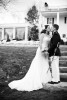 Groom, Duncan Mark Carlton, 26, from Laguna Niguel, Calif., shares a kiss with his Bride, Sarah Ann Schultz, 28, from Laguna Niguel, Calif., on their wedding day, Saturday, December 29, 2012 in front of the Vesuvius Vineyard home in Iron Station, North Carolina. The couple love acting silly with each other and love barbeque food.