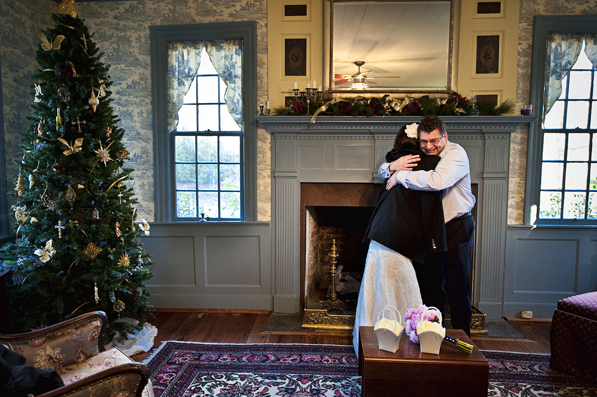Father of the Bride, Michael Schultz, from North Carolina, hugs his oldest of five daughters, bride Sarah Ann Schultz, 28, from Laguna Niguel, Calif., before he walks her down the aisle to marry her groom, Duncan Mark Carlton, 26, from Laguna Niguel, Calif., at the Vesuvius Vineyard in Iron Station, North Carolina on Saturday, December 29, 2012. This was Schultz's first of five daughters to be wed and it was an emotionally joyful day for the close father and daughter.