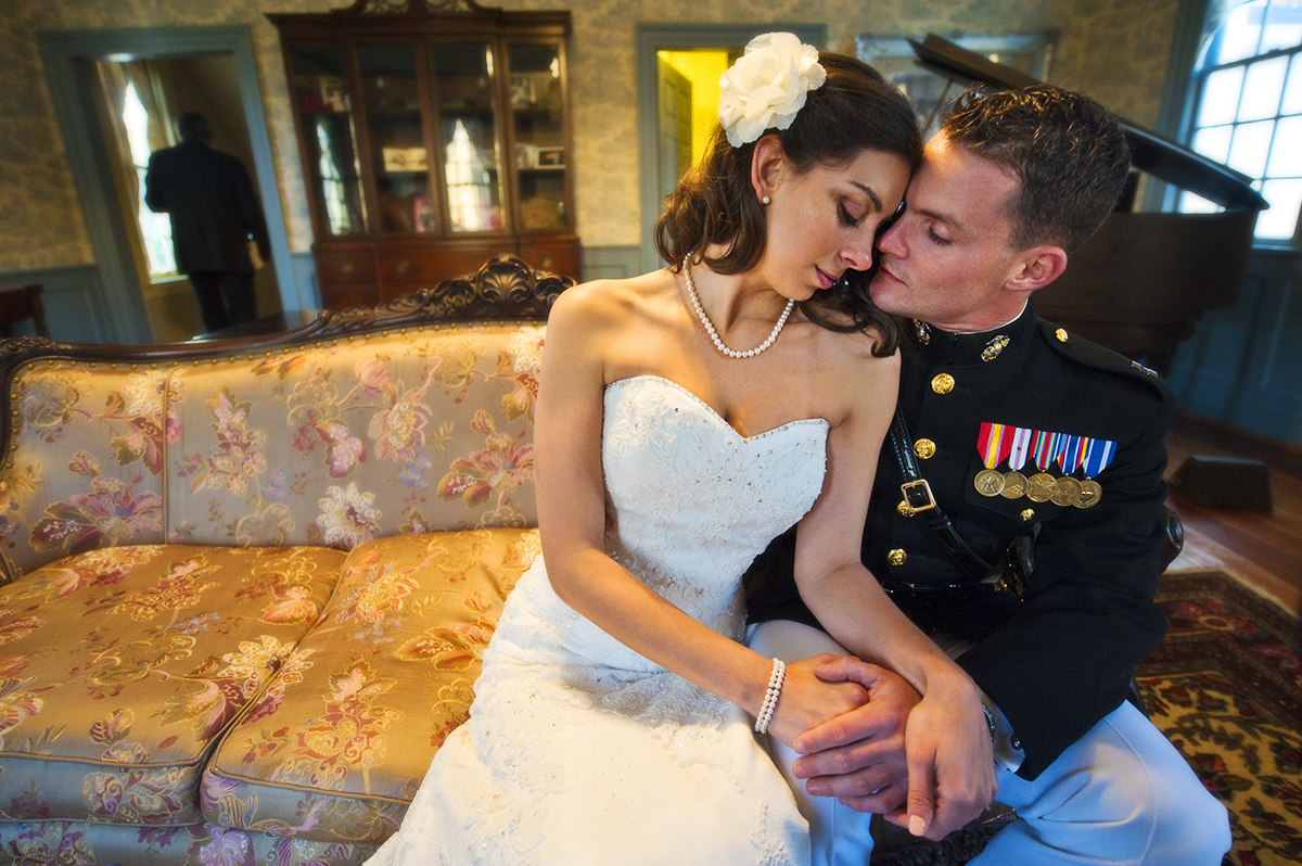 Bride, Sarah Ann Schultz, 28, from Laguna Niguel, Calif., takes a moment with her groom, Duncan Mark Carlton, 26, from Laguna Niguel, Calif., to share a romantic moment by the fireplace to keep warm before their ceremony begins at the Vesuvius Vineyard in Iron Station, North Carolina on Saturday, December 29, 2012. Just an example of the couple's wit, Carlton's facebook status the morning of the wedding was, {quote}What to do today...hmmm... I know, I think I'll get married. That should cover the day... — with Sarah Ann Carlton.{quote}