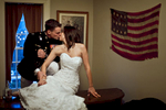 The newlywed couple, Duncan Mark Carlton, 26, from Laguna Niguel, Calif., and Sarah Ann Carlton, 28, from Laguna Niguel, Calif., celebrate their marriage kissing inside the home of their venue, Vesuvius Vineyard in Iron Station, North Carolina on Saturday, December 29, 2012. The home is stunningly beautiful with its historical vintage vibe.
