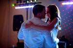 Groom, Duncan Mark Carlton, 26, from Laguna Niguel, Calif., dances with his bride, Sarah Ann Schultz, 28, from Laguna Niguel, Calif., as they show so much love for each other near to the end of their reception at the Vesuvius Vineyard in Iron Station, North Carolina on Saturday, December 29, 2012. The evening was full of non-stop dancing from all ages between four generations!