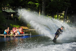 Tricia Spaulding, from Oconto Falls, Wisconsin took the perfect opportunity to spray her cousins with Kelly Lake water while skiing in front of her uncle John and Aunt Debbie Reidinger's lake front property in Suring, Wisconsin on Sunday, June 16, 2013. The best part was watching her nephew be a human barrier between his mom and the powerful splash.