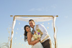 Groom, Russell Thomas, from Costa Mesa, Calif., marries Laura Palacios, from Costa Mesa, Calif., on the sands of Newport Beach, Calif., on May 1, 2015.  After their ceremony they danced all night on the Tiki Boat in the Newport Harbor under a full moon.