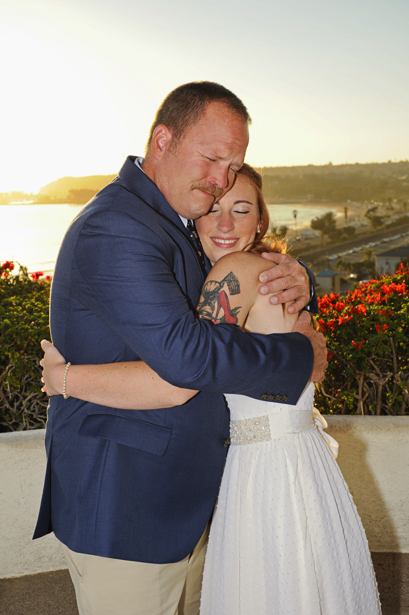 Bride, Kelly Jeans, 20, from Bloomington, Minnesota embraces her father on her wedding day in Dana Point, California on Saturday, September 19, 2015 at the Palisades Gazebo surrounded by their closest family and friends.  Following the ceremony the bride and groom enjoyed the sunset at Capistrano Beach followed by a family dinner.  Boatner is in the army and proposed to his bride at the airport.  The couple describe their relationship as full of fun, wrestling, watching Netflix, and love.