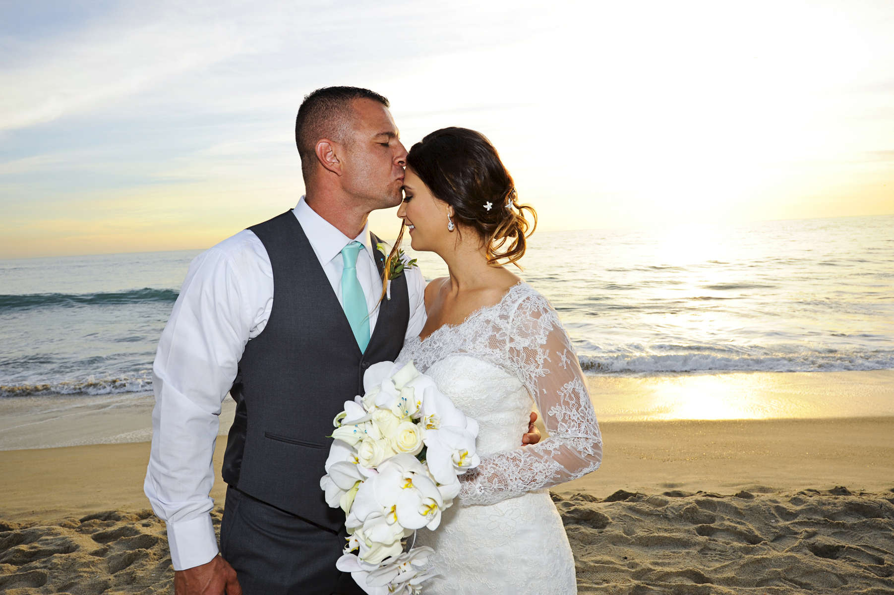Christopher John Parese and Lindsay Michelle Lopez became husband and wife on a Southern California beach in Carlsbad, Calif., on Saturday, October 24, 2015 at the Beach Terrace Inn supported by their children, family, and friends. The bride and groom look forward to {quote}spending our lives together, raising our children, and making more happy memories.{quote} (Photo by: Meagan Reidinger © 2015)