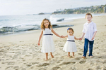 Drake Nations, 6, and his sisters, Lilah Nations, 4, and Audrey Nations, 1, from Laguna Hills, CA, loved holding hands along the sand at Aliso Beach in Laguna Beach, Calif., on Thursday, March 3, 2016.