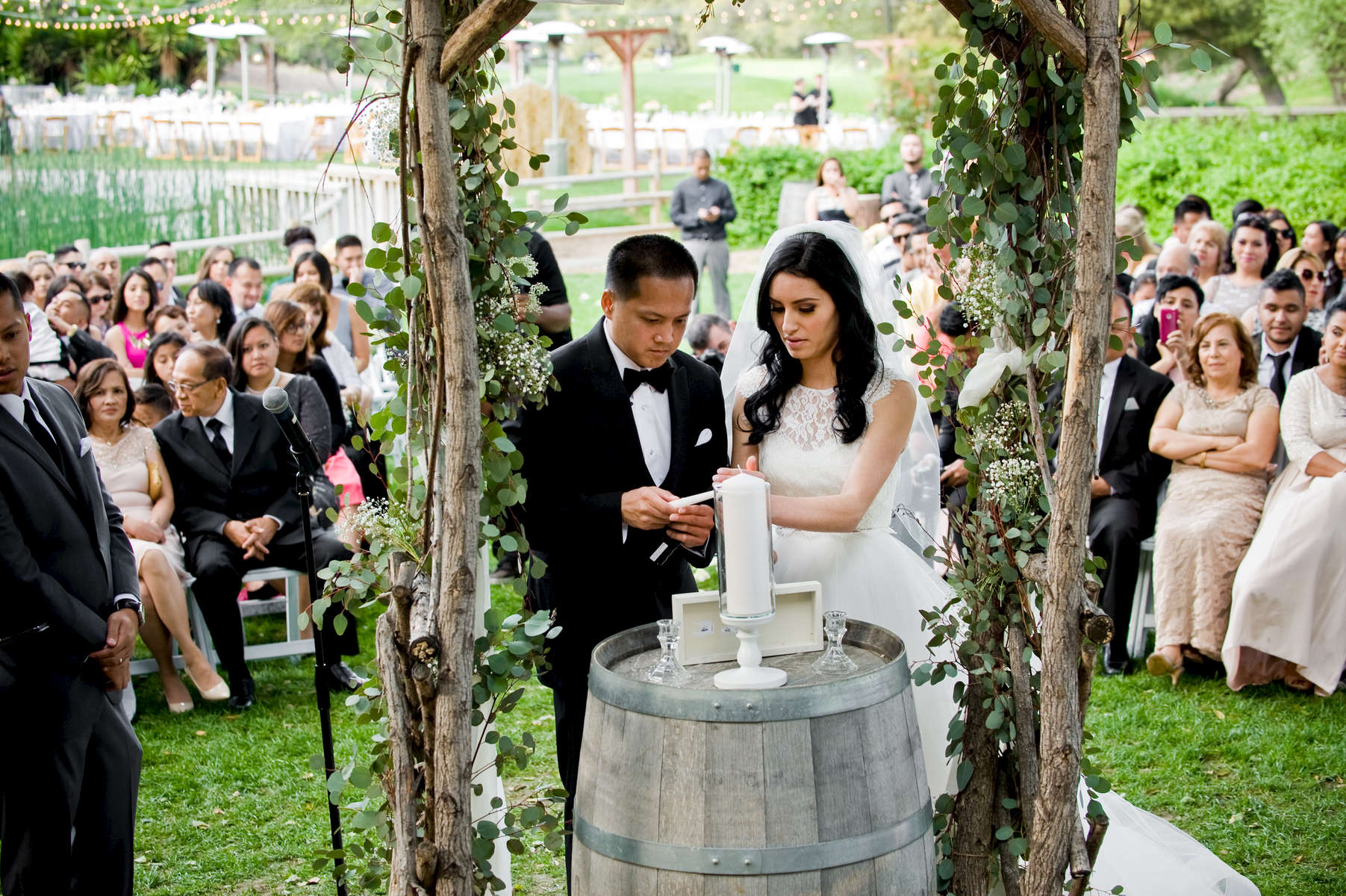 Francis Tangonan and Veronica Navarro from Buena Park, Calif., become husband and wife surrounded by their friends and family at the Temecula Creek Inn in Temecula, Calif. on Thursday, March 20, 2016.  Mr. and Mrs. Tangonan had the time of their life celebrating under the oak trees and could not to leave for their honeymoon to St. Lucia and New York the following day.  Congratulations.  (Photo by: Meagan Reidinger © 2016)