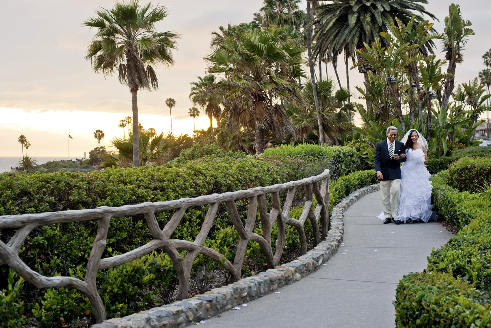 Lionel Hubbard, 47, from Long Beach, CA, marries his bride, Shannon Fowler, 38, from Long Beach, CA on Saturday, May 14, 2016 at the Laguna Beach Gazebo in Laguna Beach, CA in front of their closest friends and family members.  The bride and groom lived across from each other in the same apartment community for three years, never meeting.  Then one day, Fowler locked herself out and asked Hubbard for help.  The rest is history.