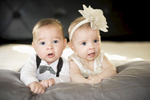 Twins, Logan and Reagan Johnsen, born April 19, 2017 are celebrating their 6 month birthday having their portraits taken in their home in Corona, California, on October 19, 2017.