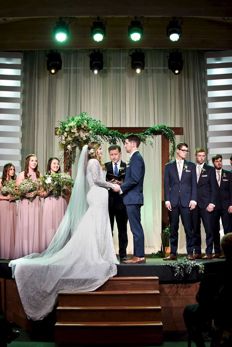 Beautiful bride, Karina Erikson, 21, marries her elementary school sweetheart, Matt Fabarez, at Compass Bible Church in Alsio Viejo, Calif., on Sunday, June 3, 2018 followed by dinner and speeches at Coto Valley Country Club in Coto De Caza, California.  The couple first and foremost follow Jesus Christ as their personal Savior and were ecstatic to celebrate their marriage with their closest friends and family.  The church members of about 600 people, witnessed their Lead Paster Mike Fabarez marry his son and daughter in law. The tear-filled speeches, mother of the bride's gift to her daughter, first look, and sparkler exit were a few of the cherished moments during the Fabarez Wedding.(Photo by: Meagan Reidinger © 2018)
