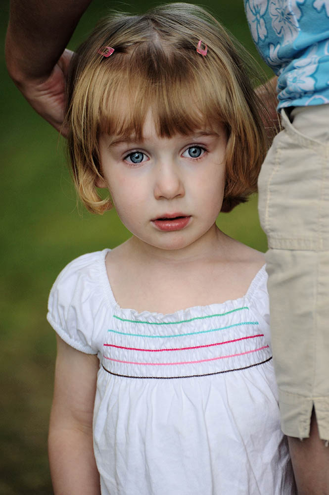 Mya Magnin, from Lena, Wisc., is staring at the lake where she wishes to go and play, but instead her mother, Angie Magnin, is trying to calm her down and convince her they need to go home on July 5, 2009 after visiting her relatives from California that come and visit once a year.