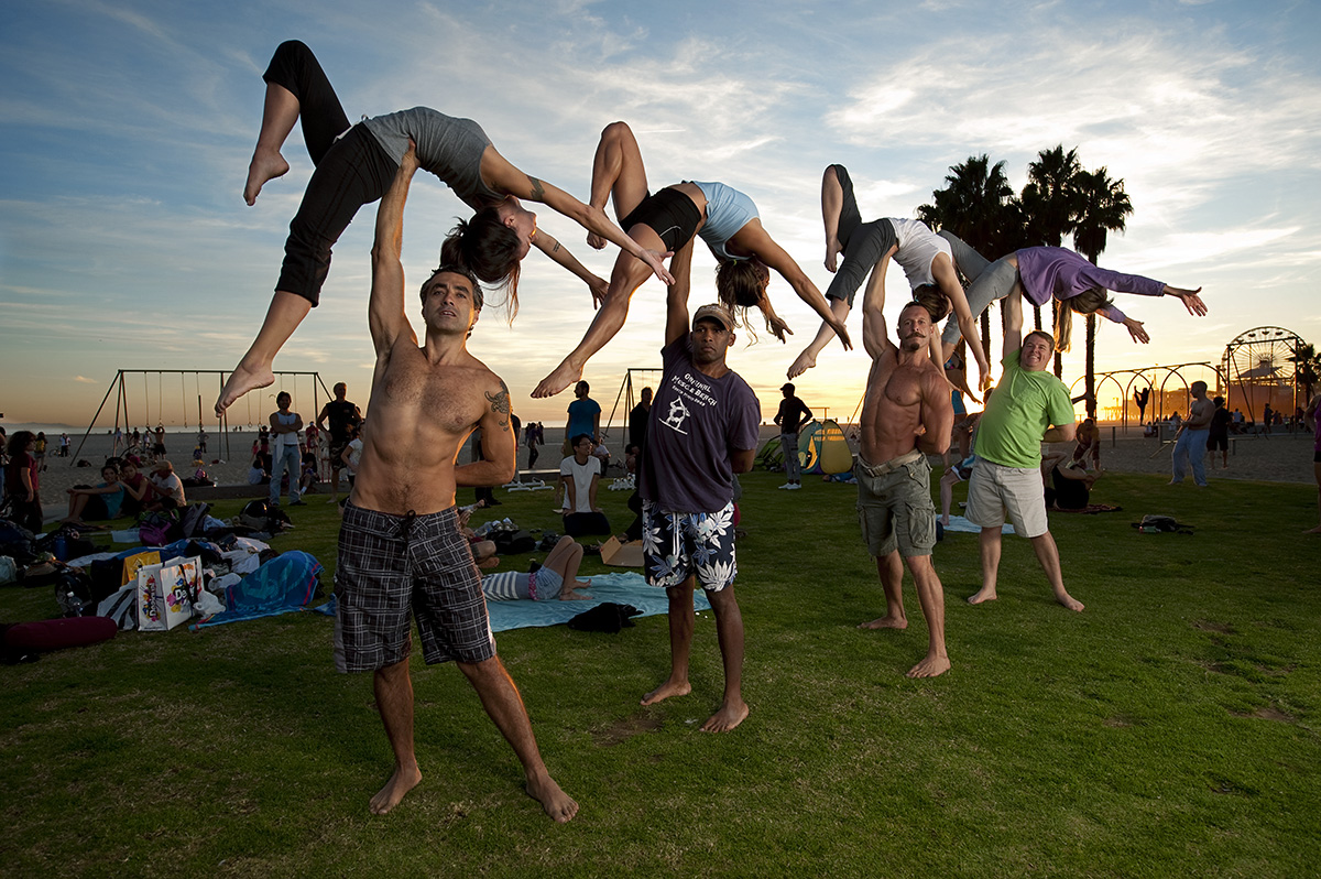 A group of regular attendees to the Original Muscle Beach perform acro sports at the Original Muscle Beach in Santa Monica, Calif., on Sunday, November 14, 2010. David {quote}Soop{quote} Frison, third male from the left, has been attending the Original Muscle Beach in Santa Monica since 1995 and thoroughly enjoys it.