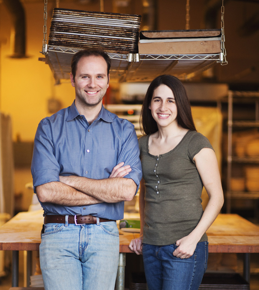 A bio picture of authors, bakers, and bakery owners Andy and Jackie King photographed in their bakery in Salem, Massachusetts