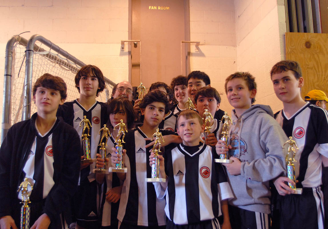 February 12 - Indoor Soccer Team with TrophiesPost a Comment