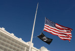 January 10Flags fly at half mast at the Federal Courthouse in Central Islip, NY for the victims of the shootings in Arizona