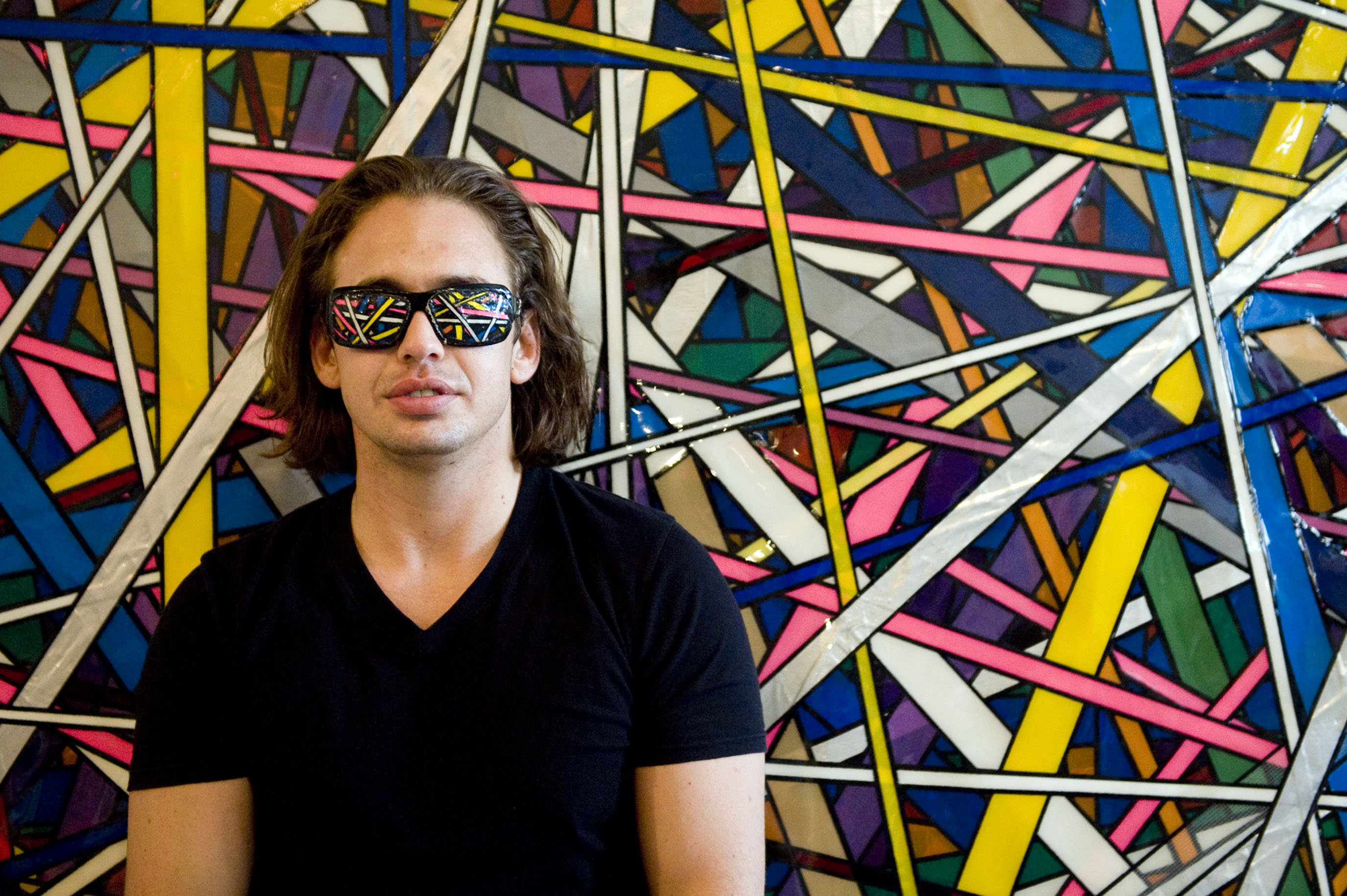 Eric Klein (E.S. Klein) makes art with duct tape. He was photographed with his piece {quote}Tangled{quote} at his home and studio in the old Wonder Bread factory. (Reena Rose Sibayan | The Jersey Journal)