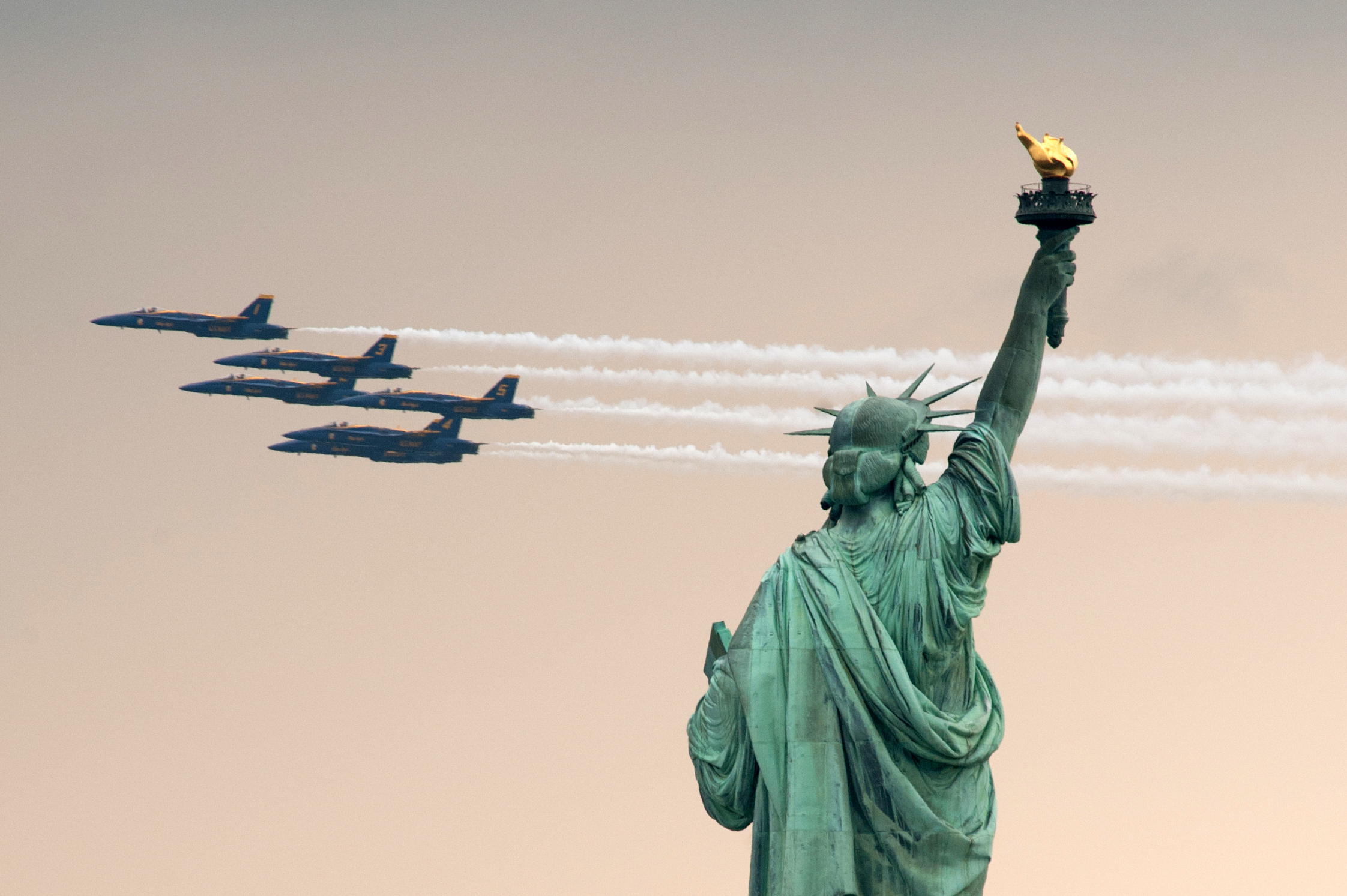 The U.S.Navy's Blue Angels Flight Demonstration Team performs a flyover with six F/A-18s past the Statue of Liberty during the parade of ships to kick off Fleet Week 2012. (Reena Rose Sibayan/The Jersey Journal)
