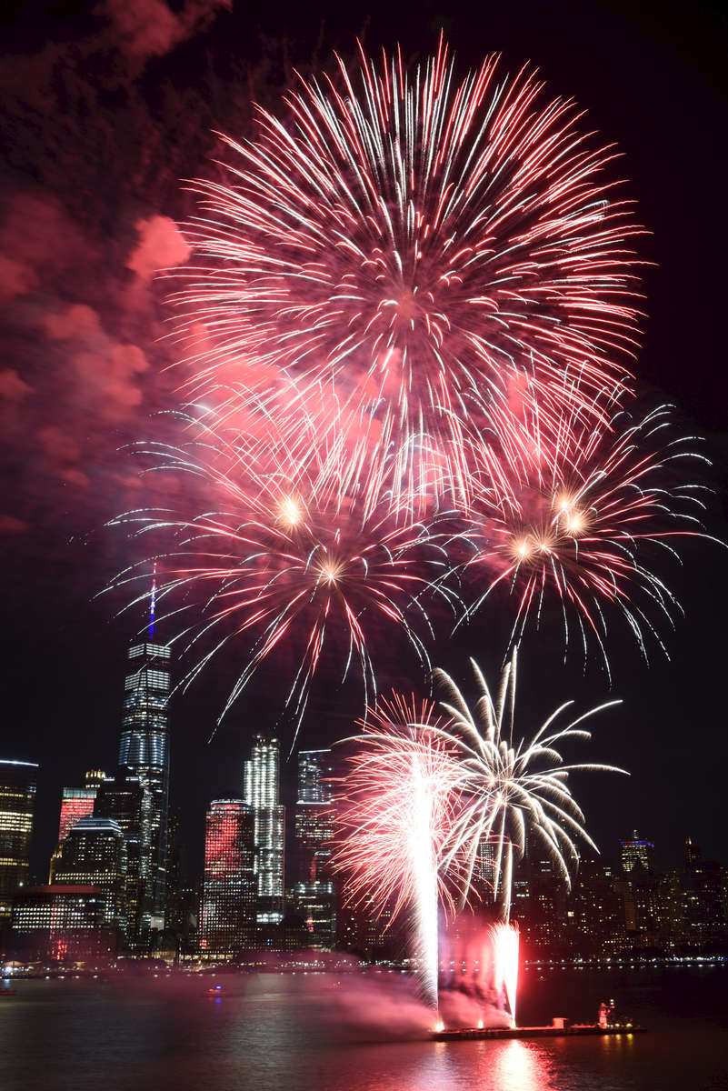 The Jersey City Fourth of July fireworks display by Grucci as seen from the Hyatt Regency hotel, with One World Trade Center in Lower Manhattan visible in the background. After three years in Liberty State Park, this year's festival was moved to Exchange Place after the state government was shut down following a budget impasse. (Reena Rose Sibayan | The Jersey Journal)