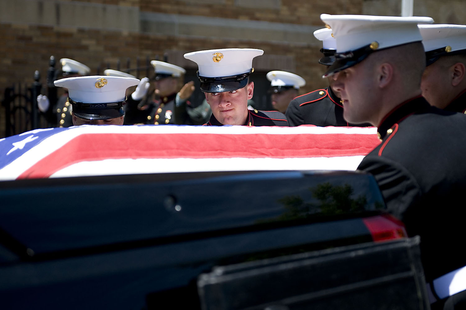 Funeral service for slain U.S. Marine Anthony Chenay Adams, 23, of Jersey City, at Monumental Baptist Church. Here, U.S. Marines place Anthony C. Adams' flag-draped casket on a pickup truck hearse after the funeral service. Police say Adams was the victim of a carjacking. Early on May 26, he was in his 2002 Ford Explorer on Bidwell Avenue when he was shot once in the chest and left ear, officials said. Earl Austin, 20, of Bartholdi Avenue, has been charged. (Reena Rose Sibayan | The Jersey Journal)