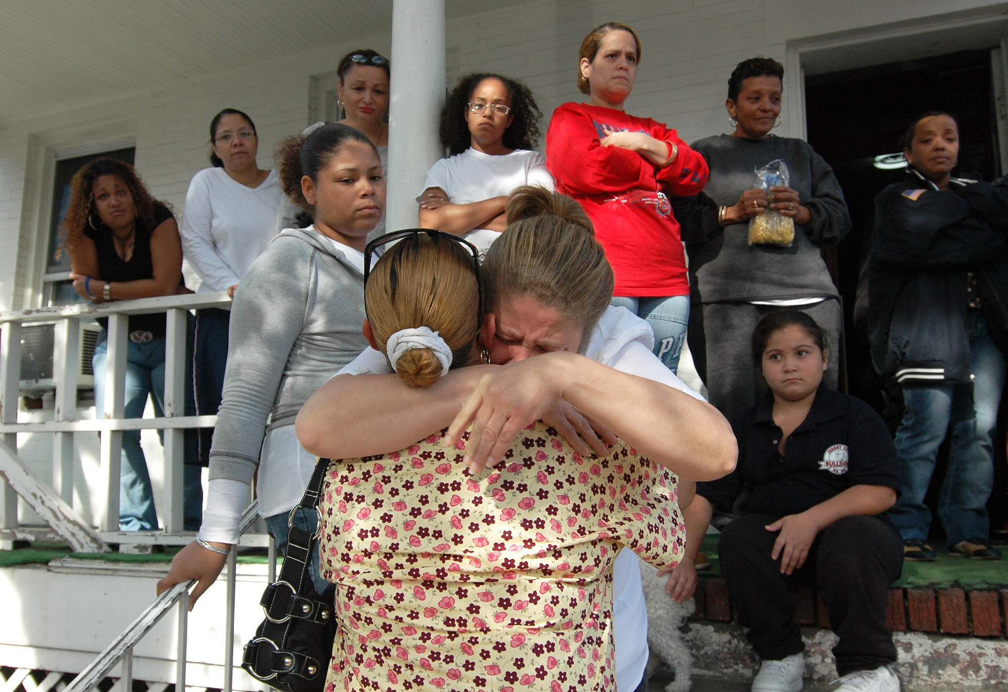 Denise Batista is comforted by her friend, Claribel Cruz, surrounded by family members and friends who gathered at her home in the Heights a day after her son, Juan Batista, 26, was shot to death in what authorities believe was a retaliatory killing in response to the shooting of a Latin Kings member earlier in the year. Denise Batista called her son {quote}a happy person{quote} who was trying to put his life back together after spending time in jail. (Reena Rose Sibayan | The Jersey Journal)