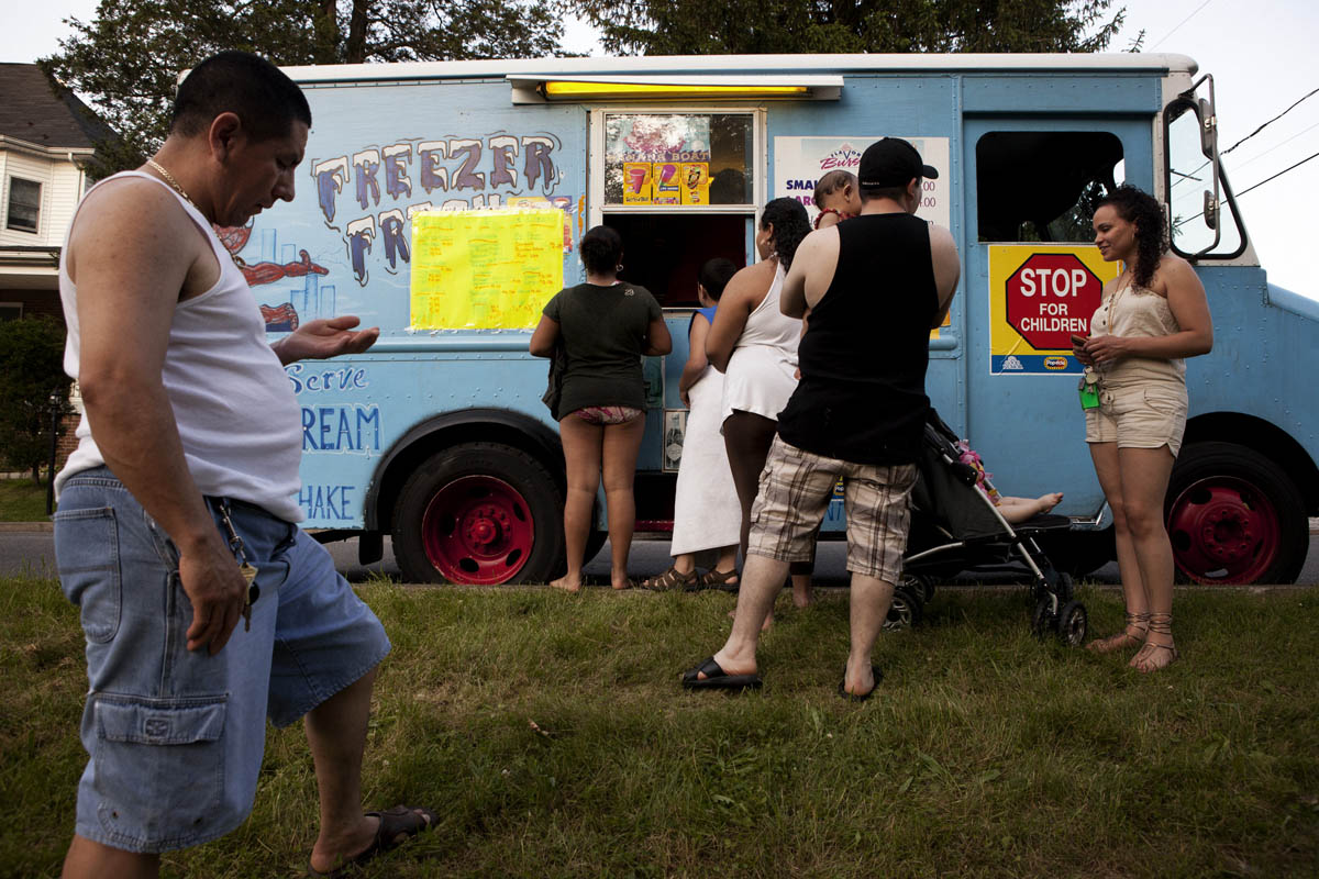 On Memorial Day, 2011, families wait for ice cream from Gerry Torres, a Puerto Rican immigrant who has served ice cream out of a truck he has owned for eight years. Saucon Park has become a well established hang out spot for the rapidly increasing Hispanic population in the Pennsylvania's Lehigh Valley.