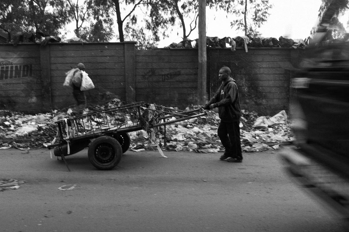 Members of the Gange Youth Self Help Group in Kibera gather trash and transport it to a local dump site four to five times a day. Gange, which means {quote}hard working,{quote} was started in 1996, and was the first youth reform project to take root in Kibera.