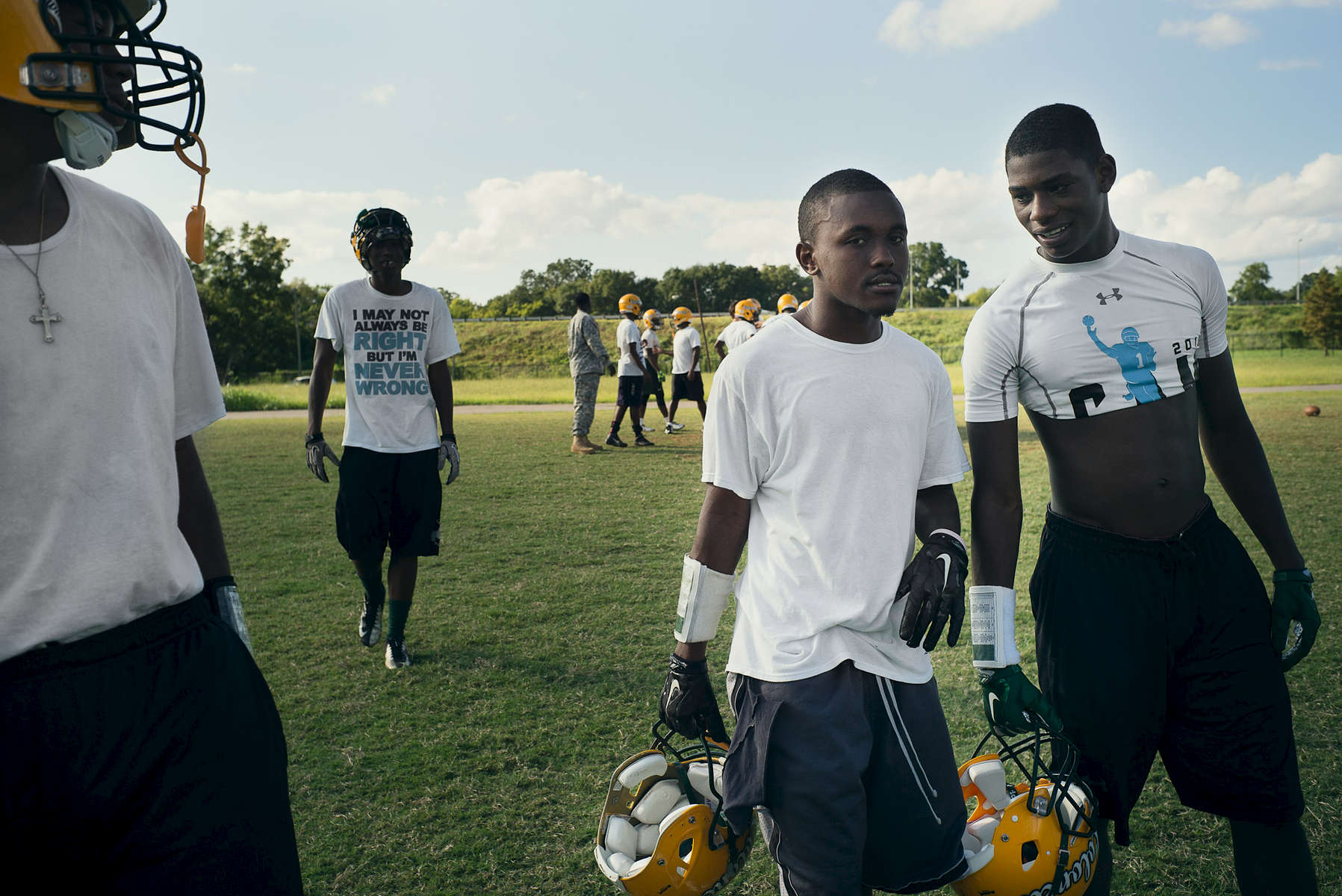 BIRMINGHAM, AL – SEPTEMBER 10, 2015: Quintarius Monroe (center) speaks with Cornelius Mosley (right) as they break from football practice at Woodlawn High School. A type 1 diabetic, Monroe requires frequent blood sugar testing and supervision when self-administering insulin. When care from qualified personnel at his school in Center Point became unavailable, Monroe was forced to transfer several miles away from his locally zoned school to attend Woodlawn High School. The Americans with Disabilities Act requires schools to provide {quote}reasonable accommodation{quote} for students with medical conditions, but given that most schools no longer retain school nurses, many schools are failing to provide adequate care for their students.CREDIT: Bob Miller for The New York Times