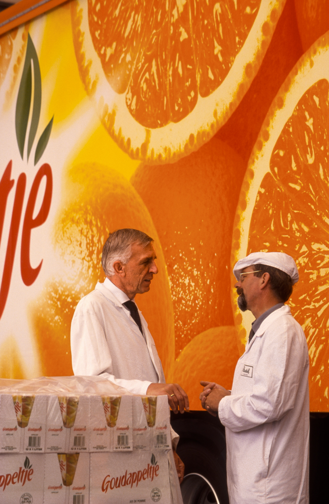 At a juice plant in Belgium, a process technical consultant and a plant supervisor stop to talk beside a delivery truck trailer