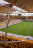Parkstad Limburg Stadium in Kerkrade, the Netherlands, home of Roda JC, seen here with its first turf, also houses a hotel and a variety of shopping venues.